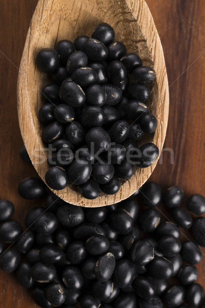 A lot of black soybeans on wooden background Stock photo © joannawnuk