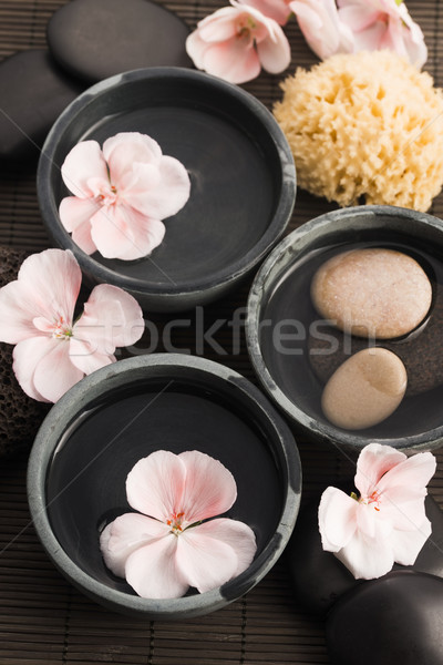 Spa still life, with pink flowers, stones and water Stock photo © joannawnuk