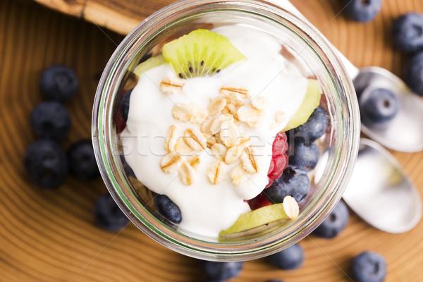 musli served with joghurt and fresh fruits Stock photo © joannawnuk