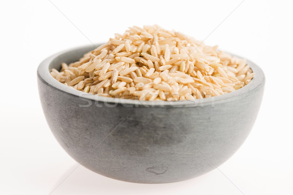 brown rice in a bowl isolated on white background Stock photo © joannawnuk