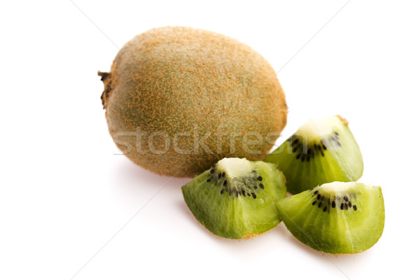 Whole kiwi fruit and his sliced segments isolated on white backg Stock photo © joannawnuk
