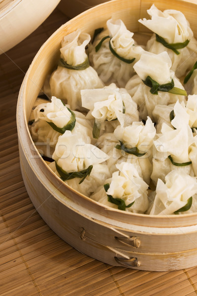 Chinese dumplings in bamboo steamers Stock photo © joannawnuk
