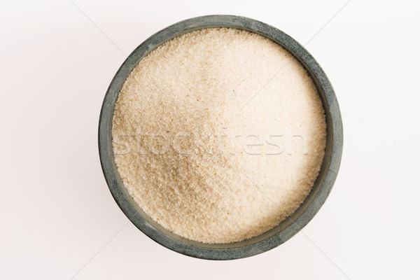 Bowl of semolina isolated on white Stock photo © joannawnuk