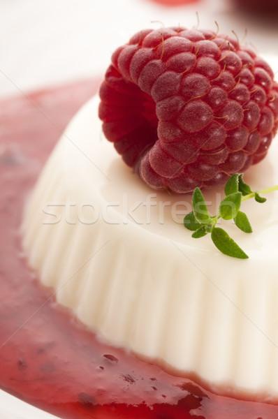Vanilla panna cotta with berry sauce Stock photo © joannawnuk