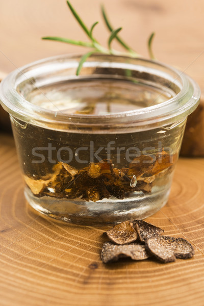 Sliced black truffle in olive oil in small jar and fresh rosemar Stock photo © joannawnuk
