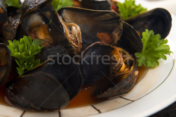 Clams in tomato sauce  Stock photo © joannawnuk