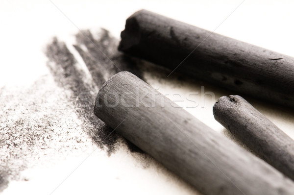 Artist's black charcoal with smudge Stock photo © joannawnuk