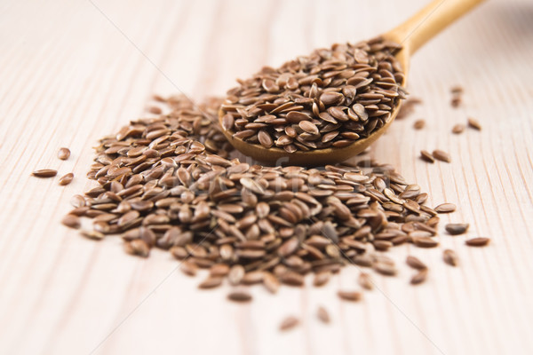 Wooden spoon with flax seed Stock photo © joannawnuk