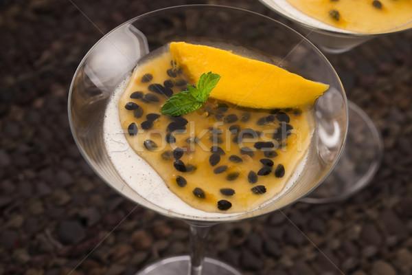 Panna cotta dessert with passion fruit and mint Stock photo © joannawnuk