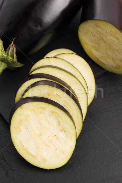 Melanzane fette coltello vegetali gocce fresche Foto d'archivio © joannawnuk