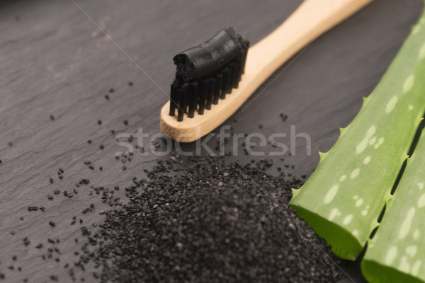 Toothbrush with black charcoal toothpaste with aloe vera Stock photo © joannawnuk