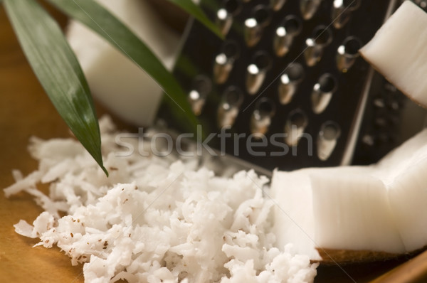 Grated coconut with grater and nut  Stock photo © joannawnuk