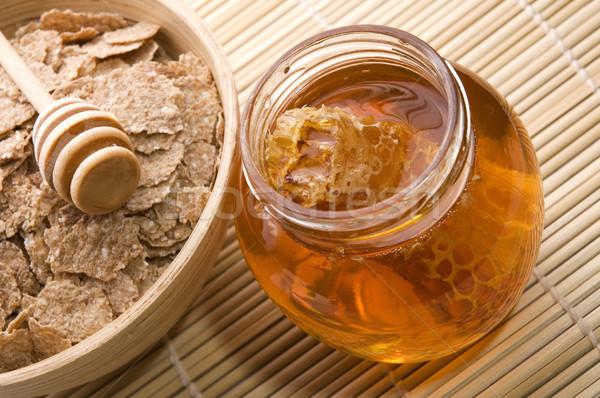 fresh honey with honeycomb and breakfast flakes Stock photo © joannawnuk