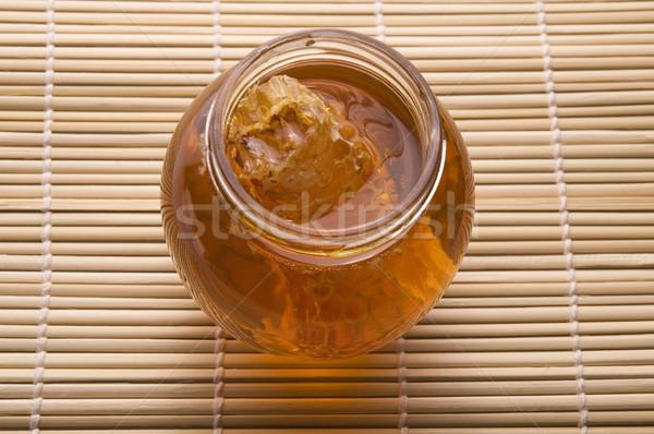 Friss méz méhsejt étel gyümölcs üveg Stock fotó © joannawnuk