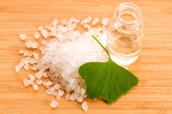 Stock photo: fresh leaves ginko biloba essential oil and sea salt - beauty tr