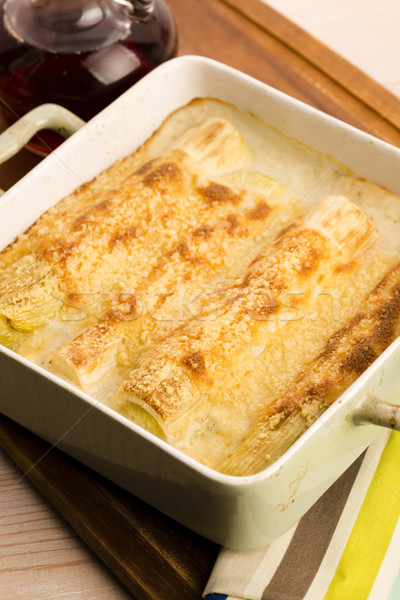 Leeks casserole with white sauce and cheese Stock photo © joannawnuk