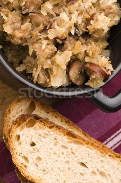traditional polish sauerkraut (bigos) with mushrooms and plums Stock photo © joannawnuk