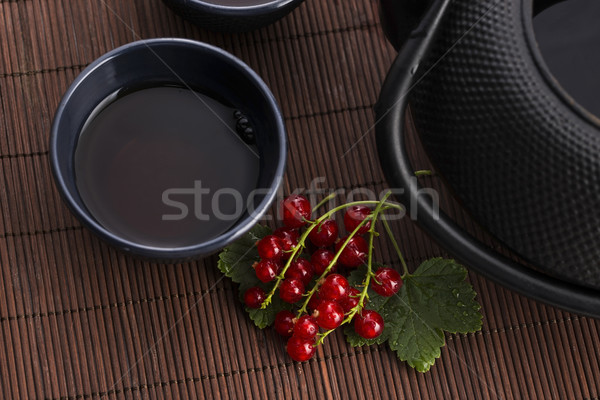 tea in cup and fresh red currant Stock photo © joannawnuk