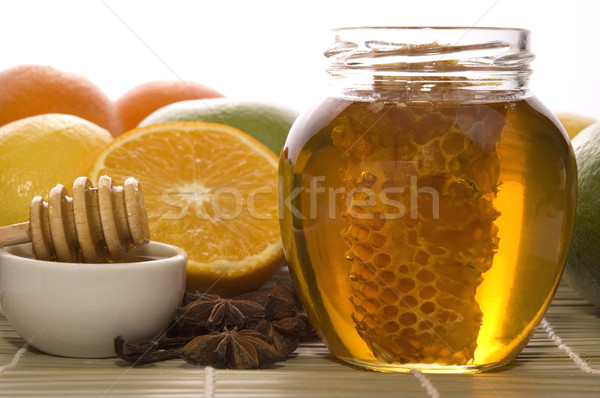 Foto d'archivio: Fresche · miele · a · nido · d'ape · spezie · frutti · limoni