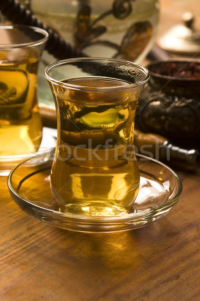 Cup of turkish tea and hookah served in traditional style Stock photo © joannawnuk