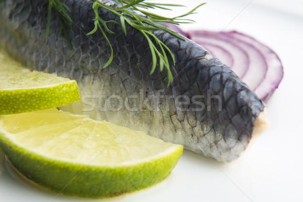 Fillet herring with onion and lemon Stock photo © joannawnuk