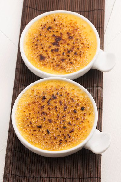 Creme brulee.French vanilla cream dessert with caramelised sugar Stock photo © joannawnuk