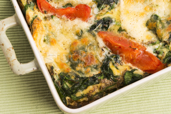 Omelet with vegetables and cheese. Frittata Stock photo © joannawnuk