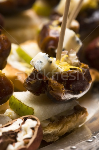 Appetizer Plate with Dactyl, Pecan nuts and Cheese Stock photo © joannawnuk