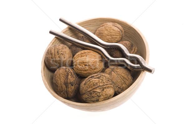 walnuts and nutcracker Stock photo © joannawnuk