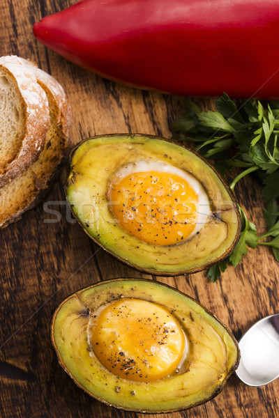 Homemade Organic Egg Baked in Avocado with Salt and Pepper Stock photo © joannawnuk