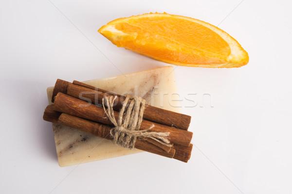 Bar of soap with cinnamon and orange Stock photo © joannawnuk