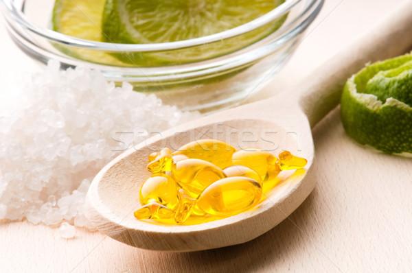 lemon bath - bath salt, capsule and fresh fruits Stock photo © joannawnuk