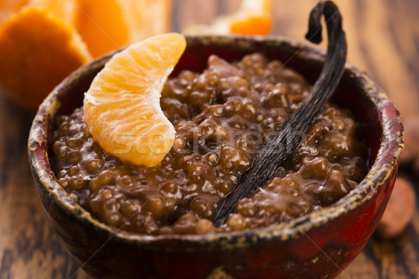 A bowl of chocolate tapioca pudding with fruits Stock photo © joannawnuk