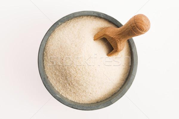 Bowl of semolina isolated on white Stock photo © joannawnuk