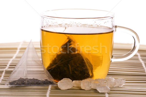 white tea, nylon tea-bag and sugar Stock photo © joannawnuk