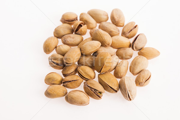 pistachios on white background Stock photo © joannawnuk