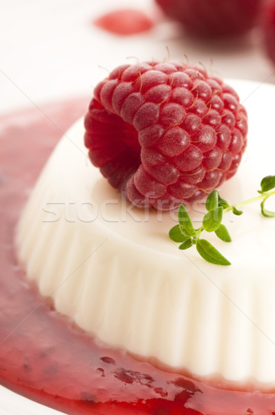 Stock photo: Vanilla panna cotta with berry sauce