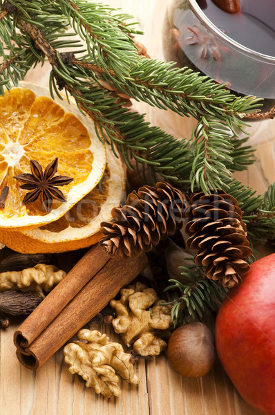 Different kinds of spices, nuts and dried oranges - christmas de Stock photo © joannawnuk