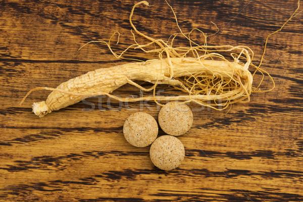 Korean ginseng. Root and pills Stock photo © joannawnuk
