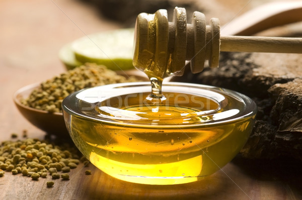 Fresh honey and bee pollen Stock photo © joannawnuk