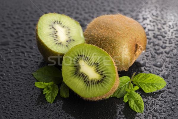 Succosa kiwi frutta menta foglie sfondo Foto d'archivio © joannawnuk