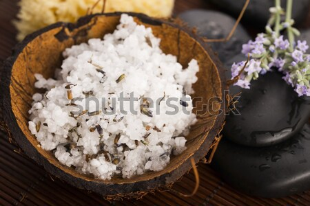 Homemade skin exfoliant (skin scrub) of sea salt, olive oil and  Stock photo © joannawnuk