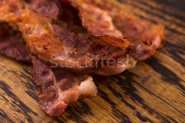 Pişmiş domuz pastırması şeritler beyaz yakın çekim Stok fotoğraf © joannawnuk