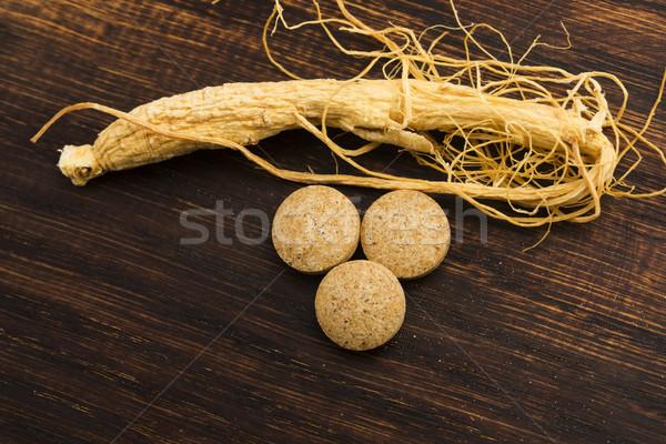 женьшень корень таблетки продовольствие медицина таблетки Сток-фото © joannawnuk