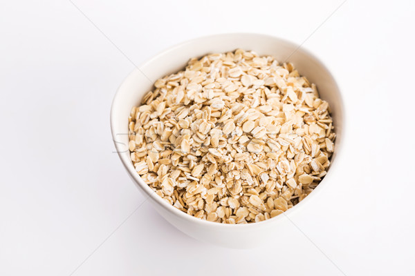 Oat flakes in bowl Stock photo © joannawnuk