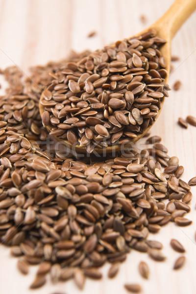 Cuchara de madera semillas salud grupo petróleo botella Foto stock © joannawnuk