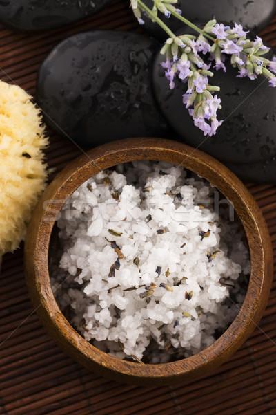 Homemade skin exfoliant (skin scrub) of sea salt, olive oil and  Stock photo © joannawnuk