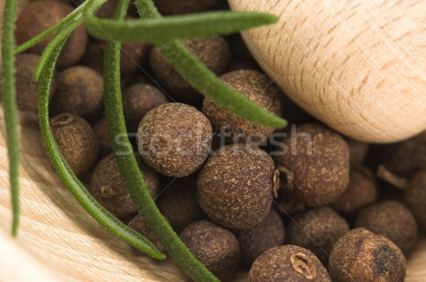 Mortar with fresh herbs and allspice berries Stock photo © joannawnuk