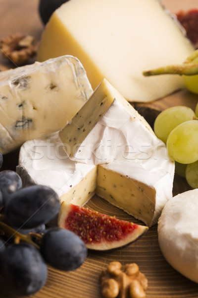Assortment of cheese with fruits and grapes Stock photo © joannawnuk