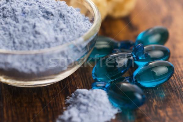 Blue clay mask with serum capsules Stock photo © joannawnuk